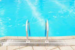 Step in the blue pool water. A step in the blue pool water royalty free stock images