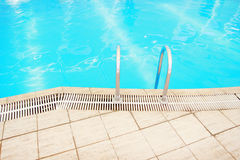 Step in the blue pool water. A step in the blue pool water stock photography