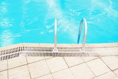 Step in the blue pool water. A step in the blue pool water royalty free stock image