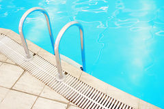 Step in the blue pool water Stock Photos