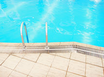 Step in the blue pool water Royalty Free Stock Photo