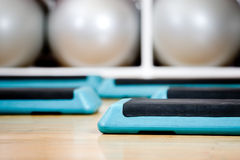 Step boards and gymnastic balls Royalty Free Stock Images