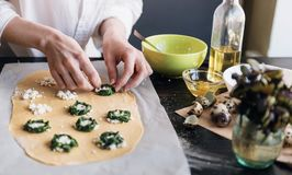 Step by step the chef prepares ravioli with ricotta cheese, yolks quail eggs and spinach with spices. The chef prepares the fillin. G on the dough Stock Images