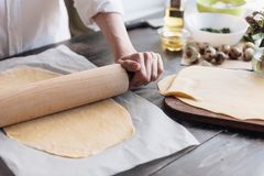 Step by step the chef prepares ravioli with ricotta cheese, yolks quail eggs and spinach with spices. The chef works with the doug. H Royalty Free Stock Image