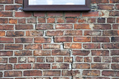 Step cracking to brickwork. Step cracking damage to brickwork in a wall beneath a window as a result of subsidence stock photo