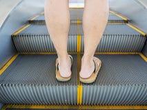 Step on escalator Stock Photos