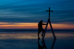 Step of Faith. Man making a step of faith to the cross of salvation Stock Photo