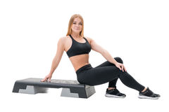 Step fitness trainer with stepper at studio Royalty Free Stock Images