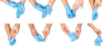 Step of hand throwing away blue disposable gloves. Step of hand throwing away blue disposable gloves medical, Isolated on white background. Infection control Royalty Free Stock Images