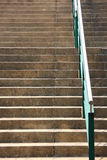 Step and handrail. Sand step and green handrail royalty free stock photos