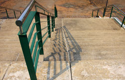 Step and handrail. Sand step and green handrail, down direction royalty free stock images