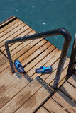 Step-ins on the sea pier stairs Royalty Free Stock Photo