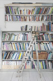 Step Ladder By Book Shelves Stock Image
