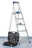 Step-ladder with a tool box Royalty Free Stock Photo