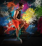 Step lesson. Instructor man does fitness with a step Royalty Free Stock Images