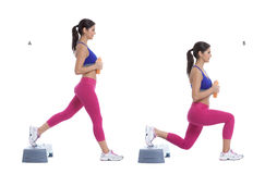 Step lunge with disc weight Royalty Free Stock Photo