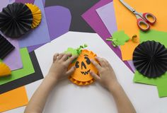 Step by step master class. Create a decoration for a party from Halloween pumpkins. stock image