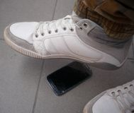 Step on the mobile phone Stock Images
