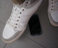 Step on the mobile phone Stock Photos