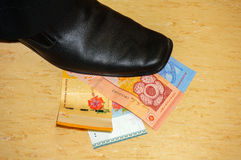 Step on money Royalty Free Stock Images