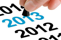 Step Into The New Year 2013. Hand with the game piece taking the next step to the next year 2013 Stock Photography