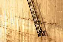 Step no Further. Man Working in The End of a Long Gangway Lowered By a Ship stock images