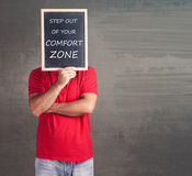 Step out of your comfort zone concept. With man holding a blackboard royalty free stock photos
