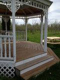 Step in. This picture is of a view of a beautiful gazebo and it's surrounding trees and other nature Stock Photo
