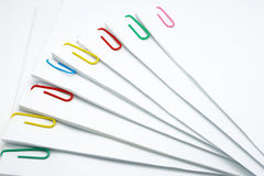 Step pile of document with colorful paperclip. On white background Stock Images