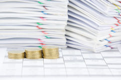 Step pile of gold coins have blur paperwork as background Royalty Free Stock Images