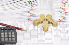 Step pile of gold coins and pencil with dual document. Step pile of gold coins and pencil with calculator on finance account have dual pile overload document of Stock Photo