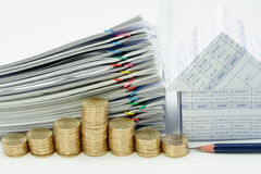 Step pile of gold coins with pencil. And house with pile overload document with colorful paperclip on white background stock image