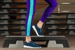 Step platform. foot on step platform. classes in the gym. fitness aerobics royalty free stock photo