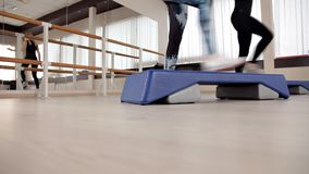 Step platforms. foot on the step platform. classes in the gym. fitness aerobics
