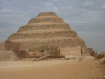 The Step Pyramid Under Repair in Cairo Egypt. The Step Pyramid is being maintained while an archaeological team discovers a new burial tomb Stock Image