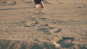 Step by step on a sand.  stock footage