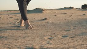Step by step on a sand.  stock video footage
