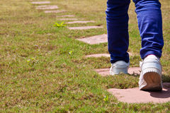 Step by Step. Step walking on the trail towards the ultimate goal Royalty Free Stock Image