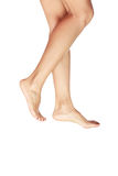 Step-by-step. Barefoot woman legs walking on a white background Stock Images