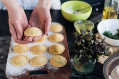 Step by step the chef prepares ravioli with ricotta cheese, yolk Stock Photo