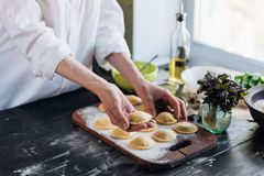 Step by step the chef prepares ravioli with ricotta cheese, yolk Stock Images