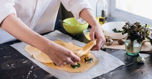 Step by step the chef prepares ravioli with ricotta cheese, yolks quail eggs and spinach with spices. The chef creates ravioli.  Stock Images