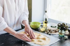 Step by step the chef prepares ravioli with ricotta cheese, yolks quail eggs and spinach with spices. The chef creates ravioli.  Stock Image