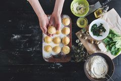 Step by step the chef prepares ravioli with ricotta cheese, yolks quail eggs and spinach with spices. The chef prepares to cook ra Royalty Free Stock Photo