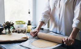 Step by step the chef prepares ravioli with ricotta cheese, yolks quail eggs and spinach with spices. The chef works with the doug. H Royalty Free Stock Photos