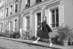 Step by step. Guide to spare time in French capital. Woman total red outfit enjoy walk beautiful street Paris. Parisian. Carefree relaxed walks on sunny day royalty free stock photo