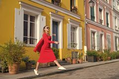 Step by step. Guide to spare time in French capital. Woman total red outfit enjoy walk beautiful street Paris. Parisian. Carefree relaxed walks on sunny day royalty free stock photos