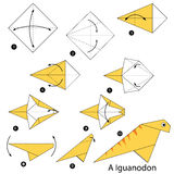 Step by step instructions how to make origami A Dinosaur. Royalty Free Stock Photo