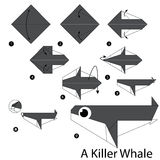 Step by step instructions how to make origami A Killer whale. Royalty Free Stock Photo