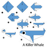 Step by step instructions how to make origami A Killer Whale. Stock Image